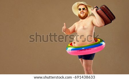 Thick funny man in swimming trunks wearing a hat and crocheted o #691438633