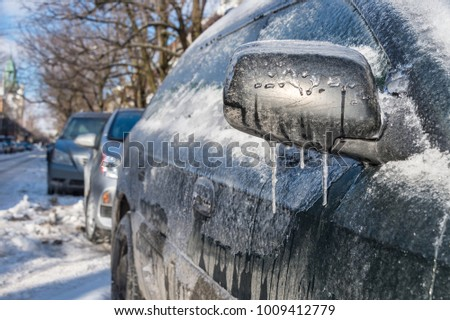 Thick layer of ice covering car after freezing rain in Montreal, Canada #1009412779