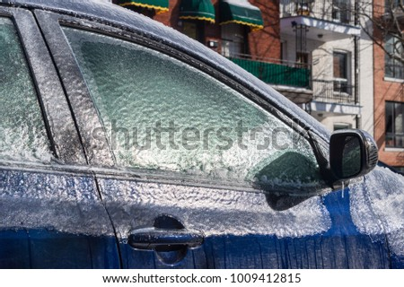 Thick layer of ice covering car after freezing rain in Montreal, Canada #1009412815