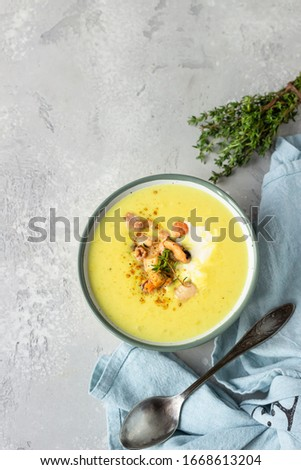 Thick milky chowder soup with seafood served with sour cream, thyme and pepper. Light grey stone background. Top view. Photo stock ©