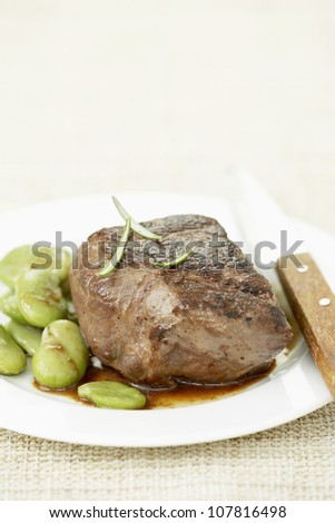Thick piece of beef with fava beans