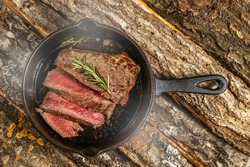 Thick sliced steak made with skillet (cast iron frying pan)