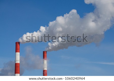 Thick smoke of the factory chimneys #1060240964