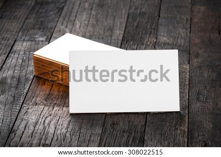 thick white cotton paper business card mock up with brassy foil on the edges