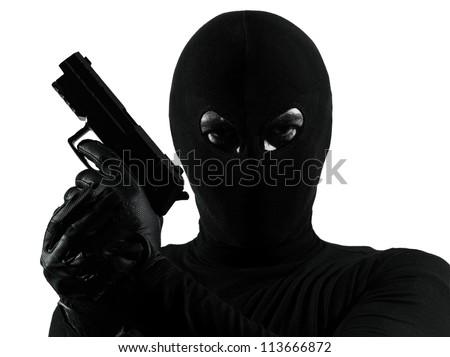 thief criminal terrorist holding gun portrait in silhouette studio isolated on white background