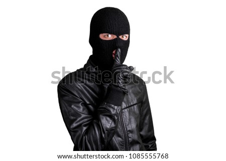 Thief in a mask showing sign quieter, isolated on a white background