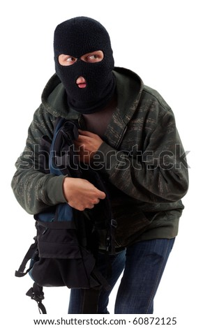 thief in black balaclava with stolen backpack