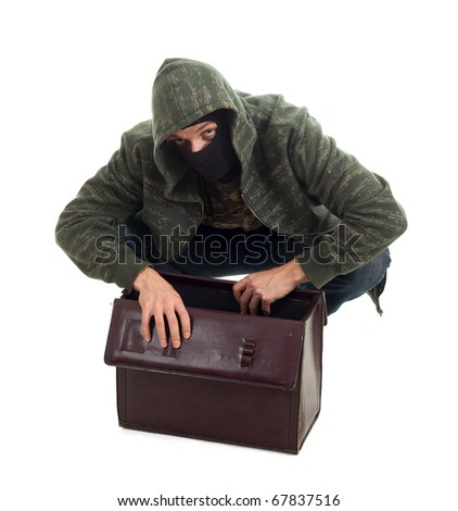 thief in black balaclava with stolen suitcase