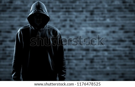 Photo of  Thief in black clothes on grey background