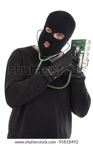 Thief listening to a computer chip with a stethoscope