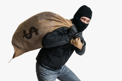 Thief robbed bank and is carrying full bag of money. Isolated on white background.