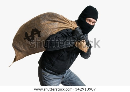 Thief robbed bank and is carrying full bag of money. Isolated on white background. Foto stock ©
