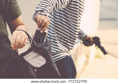 Thief stealing smart phone wallet  handbag woman violence victim unsafe ,Dangerous criminal of women in city, Thief steal and robber Concept. copy space vintage tone style. Foto stock ©