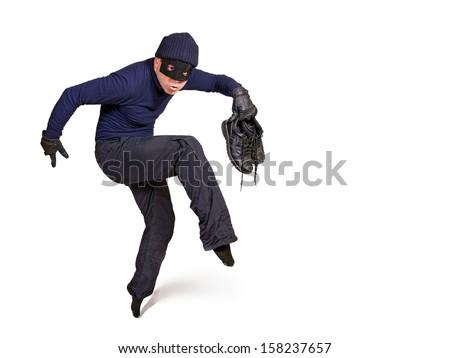 thief walking on tiptoe