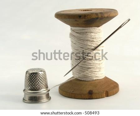 thimble, needle and thread