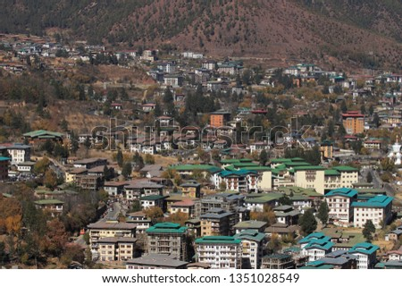 THIMPHU, BHUTAN -NOV 27 : Top view of the densely packed dwellings down the hill in the valley of Thimphu on November 27, 2018 in Thimphu, Bhutan