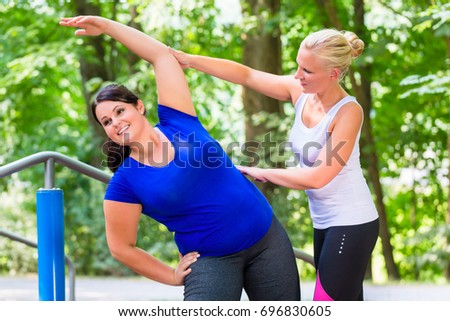 Thin and overweight woman workout together outdoors Stock photo ©