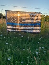 Thin blue line flag at sunset