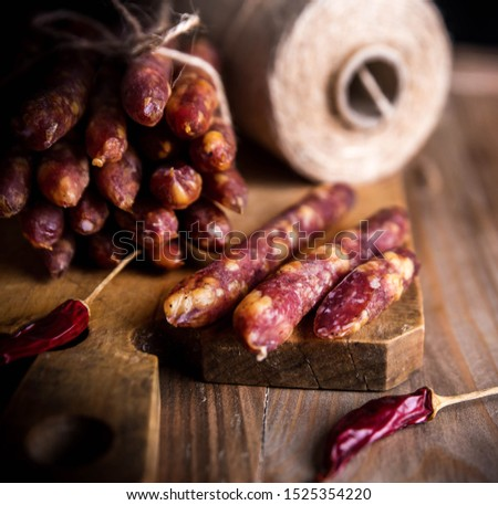 Thin uncooked smoked pork and beef sausages. Delicatessen meat.