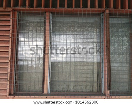 Thin wire frame grill on windows. #1014562300