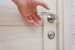 things and objects in everyday life and human life through which germs and viruses spread, door handle in an apartment in a room or house with hand and finger