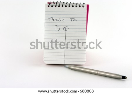 Things To Do note pad and pen on white background