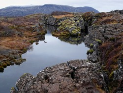 Thingvellir, a fissure in the earth's crust where the european and american continents slowly drift apart. It's also the place where the first Icelandic parliament seated.