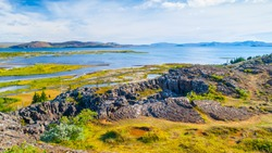 Thingvellir National park with beautiful lakes and tectonic rock formations, Iceland.