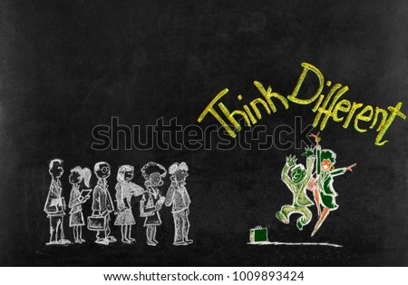 Think Different concept on blackboard