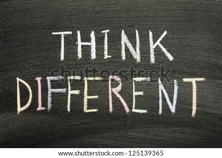 think different phrase handwritten on school blackboard