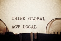 Think global act local phrase written with a typewriter.