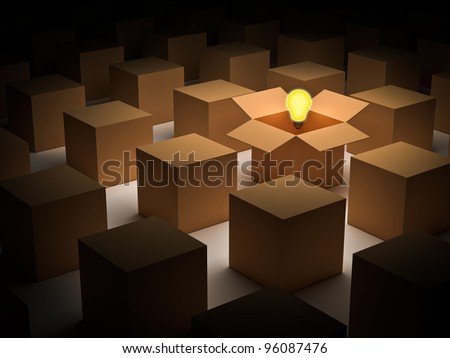 Think outside the box and individuality concept, one glowing light bulb over opened cardboard box
