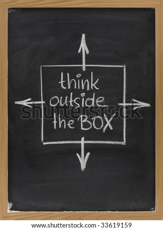 think outside the box - concept of different or unconventional thinking sketched with white chalk on a blackboard with eraser smudges