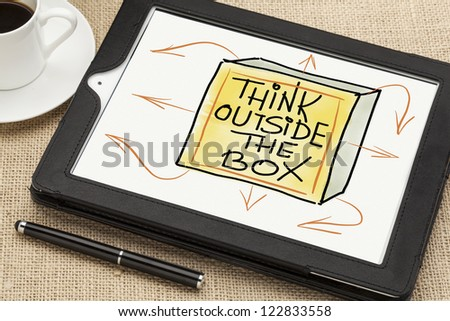 think outside the box - sketch on digital tablet  with a coffee cup and stylus pen