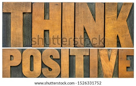 Think positive -isolated  word abstract in vintage letterpress wood type blocks, optimism and mindset concept