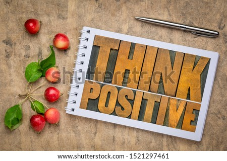 Think positive - word abstract in vintage letterpress wood type in an art sketchbook, flat lay with crab apples, optimism, thinking and mindset concept #1521297461