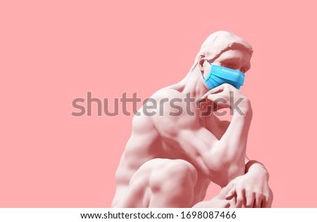 Thinker In Medical Mask On Pink Background. Novel Coronavirus (Covid-19). Concept Of Coronavirus Quarantine. 3D Illustration.  ストックフォト ©