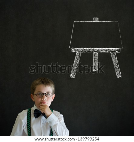Thinking boy dressed up as business man with learn art chalk easel on blackboard background