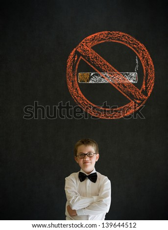 Thinking boy dressed up as business man with no smoking chalk sign on blackboard background