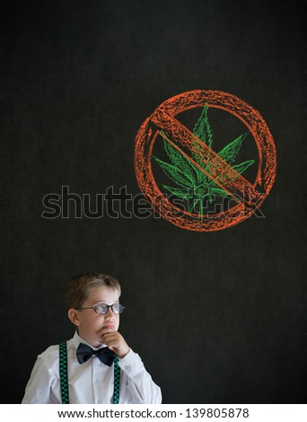 Thinking boy dressed up as business man with no weed marijuana on blackboard background