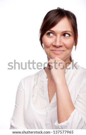 Thinking business woman smiling looking up at copy space isolated on white background