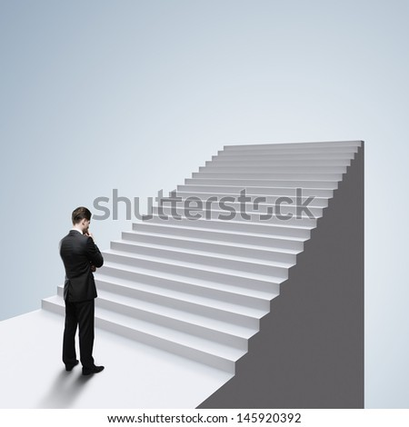 thinking businessman standing near ladder