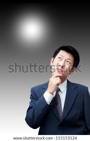 Thinking businessman with background