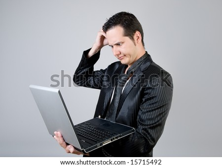Thinking casual businessman with laptop