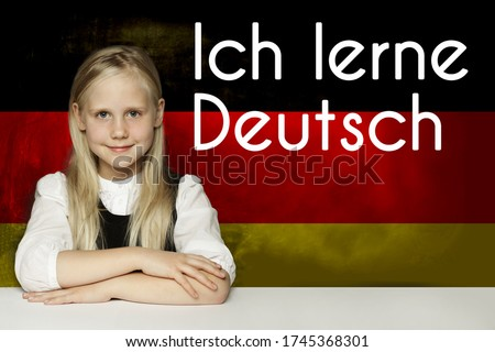 Thinking child girl student against the Germany flag background. Deutsch concept with inscription learn Deutsch on Deutsch language Stock foto ©