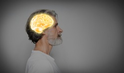 Thinking concept, space for text. Mature man and illustrated brain on grey background