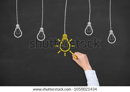 Thinking human with idea bulb in bubble on chalkboard background #1050021434