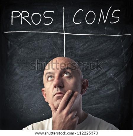 Thinking man. Background blackboard
