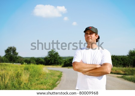 Thinking man outdoors looking forward on the road
