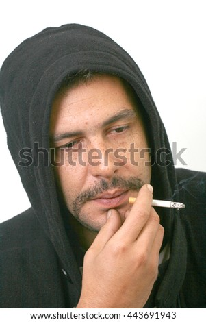 Thinking  man with cigarette wearing hooded jumper.